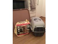 Puppy carrier, training pads and tray