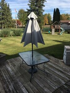 Table and umbrella for sale
