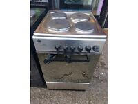 NEWWORLD 50CM SOLID TOP ELECTRIC COOKER IN SHINY SILIVER.