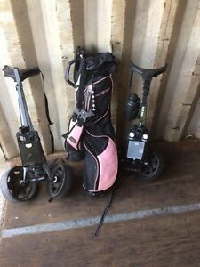 Two golf bag carts and ladies right hand pink Wilson golf bag