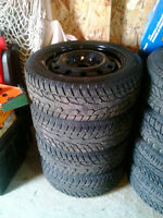 studded winter tires  and steel rims for mazda 3 2005