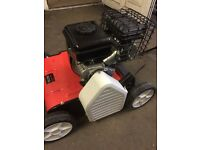 New petrol scarifier in cardboard box with manual grass collector ect