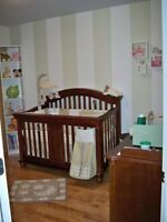 Crib converts to a day bed and a twin bed