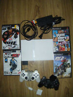Limited edition white ps2 slim with 4 games