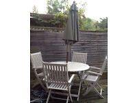 Garden chairs, table and umbrella