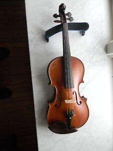 A vintage French violin with lion head