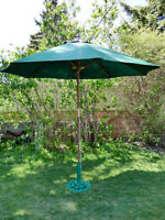 Pier 1 Wooden Umbrella with a Green fabric shade.
