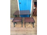 Cast iron table and stools