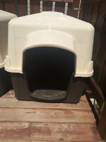 Dog house (plastic) Brand new $125, yours for $50
