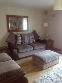 Two 3 seater sofas & puff