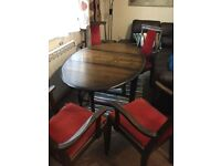 Solid Wood Drop leaf Oval dining table and 4 armchairs.