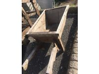 Ornamental wooden wheel barrow rolls only £25