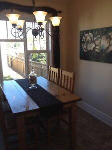 Beautiful wood table - seats 6! Comes with two captains chairs! Strathcona County Edmonton Area image 1
