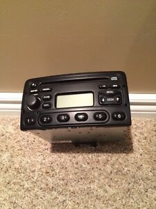 Car stereo. 2003 Ford Focus AM/FM CD player.