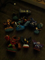 11 skylander pieces + 2 games + 2 portal
