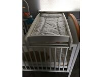 Baby over cot changing unit