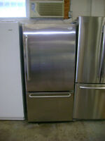 GE stainless fridge with freezer on the bottom. 90 day warranty.