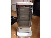 PORTABLE HALOGEN HUMIDIFIER OSCILLATING HEATER. MULTI DIRECTIONAL. 1200KW
