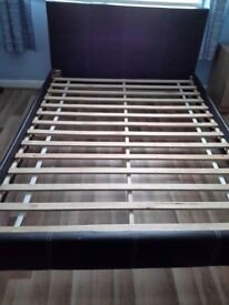 HEAVY WOODEN DOUBLE BED IN CHOCOLATE BROWN, SUEDE HEADBOARD, CAN DELIVER TO NORWICH