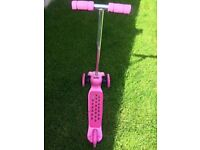 Pink three wheeled scooter