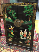 black cabinet with geishas and flowers