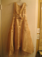 FOR SALE BEIGE,TAUPE GRADUATION GOWN SIZE 10