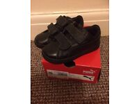 Like new boys puma black trainers. Boxed. Size 7 (child's)