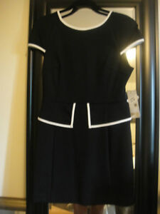 women's black and white peplum dress