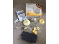 Medela swing breast pump electric or battery + storage bags