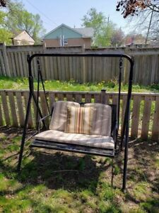 Outdoor swing chair with Sunbrella cushions