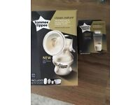 Brand new Tommee Tippee breast pump and milk pouches