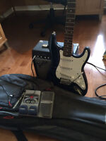 Fender Electric Guitar (with amp, cords, pedal and case)