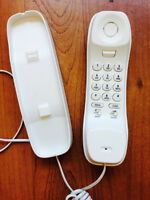 Uniden Slimline Corded Phone FOR sale at only $8...never used..