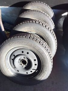 ^** GOODYEAR WINTER TIRES ON STEEL RIMS 5x114.3