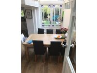 Solid Wood Oak Dining Table Extendable and 6 Brown Leather Chairs in a good condition
