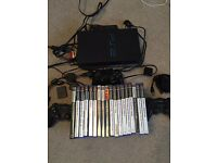 PlayStation 2 with 3 controllers eye toy and 18 games