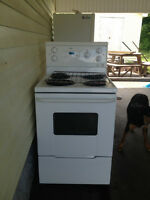 Refrigerator and oven.
