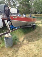 14 ft Lund fishing boat with 18 HP Mercury motor