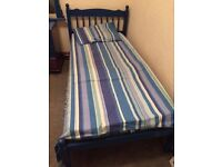 Wooden single bed with mattress and covers £30