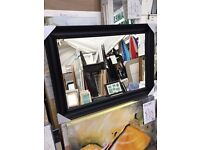 chunky black scallop wooden framed mirror