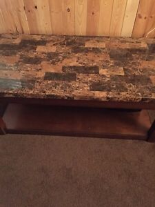 Coffee table and two end tables by Ashley Furniture