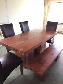 Solid hard word table and genuine dark brown leather seats with hardwood bench