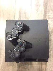 PS3 Slim + Controllers/Games