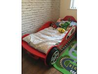Single car bed with mattress.