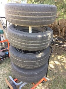 3 Michelline + 1 Goodyear 175/65/14 all season tires with rims