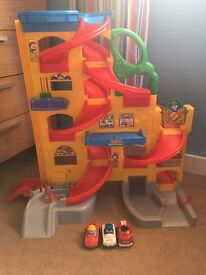 Fisher price car ramp with3 cars