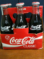 Coca-Cola Glass Bottles in Case Circa 1986 on bottle All