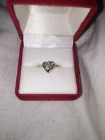 Beautiful 10K gold ring for sale!! With a heart and size 5.5!