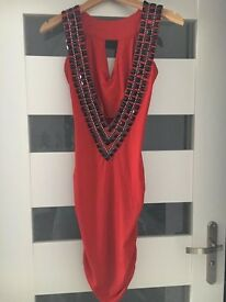 Red dress with black stones, excellent for the party