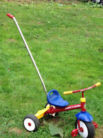 Radio flyer tricycle with bar to push